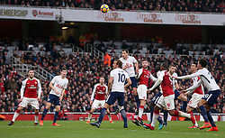 Arsenal's Shkodran Mustafi (centre right) scores his side's first goal of the game during the Premier League match at the Emirates Stadium, London.
