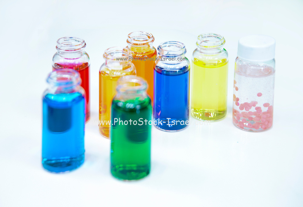 Glass bottles with coloured liquid at a Cosmetics manufacturer