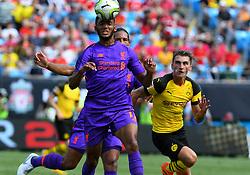 July 22, 2018 - Charlotte, NC, U.S. - CHARLOTTE, NC - JULY 22: Liverpool defender Joseph Gomez (12) heads the ball during an International Champions Cup match between LiverPool FC and Borussia Dortmund on July 22, 2018 at Bank Of America Stadium in Charlotte,NC.(Photo by Dannie Walls/Icon Sportswire) (Credit Image: © Dannie Walls/Icon SMI via ZUMA Press)