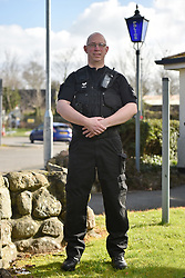 """EXCLUSIVE: A POLICE OFFICER WHO BEAT A DEADLY BOWEL CONDITION HAS NOW BECOME BRITAIN'S ANSWER TO ROBOCOP WEARING TITANIUM ARMOUR OVER A STOMA BAG WITH PIX By Magnus News Agency A police officer who bravely beat a deadly bowel condition has revealed he now wears RoboCop-style titanium armour to protect his tummy under the uniform. Dad Ed Rowland is a serving officer with Devon and Cornwall Police and lives with his wife Kate, also a police officer, and their three-year-old Maggie. Ed's ordeal began in 2006 – two years after joining the police - when he became ill after a lads' holiday to Turkey in his early 20s. What he thought was a typical holiday tummy bug soon became a nightmare with constant pain and bleeding from a condition later diagnosed as ulcerative colitis – a form of inflammatory bowel disease. After almost a decade of pain and discomfort doctors told Ed they could do no more and his large intestine was removed – meaning he now has to wear an Ileostomy bag. Because of his frontline role as a custody sergeant Ed, 36, needs protection and he found it in the form of specially built US titanium armour which covers his stoma bag. He said: """"When I'm wearing the titanium armour it does make me feel a bit like RoboCop. I must be the only titanium armoured police officer in Devon, or perhaps the country. """"Like the film said; I'm part man, part machine, all cop. """"Thankfully, our guests in the custody suite know I'm only here to help."""" Ed was able to come up with the armoured solution with support from colleagues, his wife Kate, who is also a police officer, and the National Disabled Police Association. He said: """"I did some research and found something from the US called Ostomy Armor (sic), which protects the stoma bag with a titanium armour and a Kevlar cover. """"It was developed over in the US mainly for veterans from the military, so they could carry on working and do sports and stuff. """"I said (to the Force) this is an option, would"""