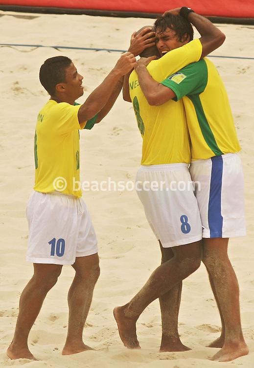 Football - FIFA Beach Soccer World Cup 2006 - Semi Final - BRA X POR - Rio de Janeiro - Brazil 11/11/2006<br />Bruno (BRA) celebrates his goal with his team-mates Junior Negao and Benjamin (10) during the match Event Title Board Mandatory Credit: FIFA / Ricardo Moraes
