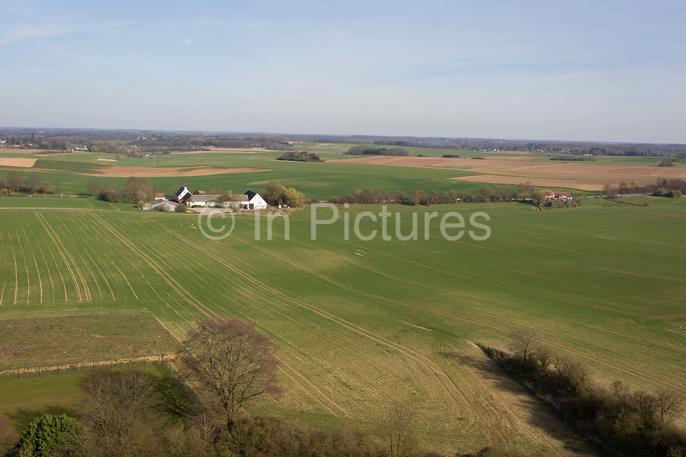 The landscape of fields and farming land including La Haye Sainte farm, the location of the Battle of Waterloo, on 25th March 2017, at Waterloo, Belgium. La Haye Sainte has changed very little since it played a crucial part in the Battle of Waterloo on 18 June 1815.<br /> It was defended by about 400 British and German troops, hopelessly outnumbered by attacking French but held out until the late afternoon when they retired because their ammunition had run out. If Napoleon Bonapartes army had captured La Haye Sainte earlier in the day, almost certainly he would have broken through the allied centre and defeated the Duke of Wellingtons army. The Battle of Waterloo was fought on 18 June 1815. A French army under Napoleon Bonaparte was defeated by two of the armies of the Seventh Coalition: an Anglo-led Allied army under the command of the Duke of Wellington, and a Prussian army under the command of Gebhard Leberecht von Blücher, resulting in 41,000 casualties.