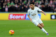 Swansea's Neil Taylor in action. Barclays Premier league match, Swansea city v Southampton at the Liberty Stadium in Swansea, South Wales on Saturday 13th February 2016.<br /> pic by  Carl Robertson, Andrew Orchard sports photography.