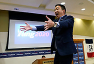 Democratic 2020 U.S. presidential candidate and entrepreneur Andrew Yang reaches for his wife after he spoke at a town hall meeting  in Sioux City, Iowa, January 27, 2020.     REUTERS/Rick Wilking