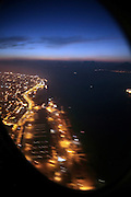 overhead view of Lisbon from airplane while landing early morning at sunrise