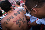 Tattooed Corinthian FC  fan inside the Morumbi statdium, home to Sao Paulo Football club to play the local derby, Sao Paulo city.
