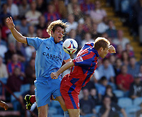 Photo: Olly Greenwood.<br />Crystal Palace v Coventry City. Coca Cola Championship. 23/09/2006. Coventry's Elliot Ward and Palace's James Scowcroft battle.