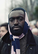 A man with a Dulwich Hamlet scarf tied around his head on the day DHFC beat Eastbourne Borough 2 - 1 at their first home game at Champion Hill on 26th December 2018 in South London in the United Kingdom. The National League South team return to their home ground, Champion Hill following a 10 month eviction initiated by the clubs landlord, Meadow Residential. During the exile, local team Tooting and Mitcham United offered a groundshare at Imperial Fields.