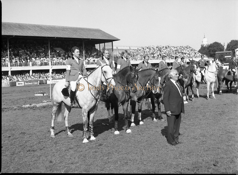 Aga Khan Cup at the RDS.    (R39)..1986..08.08.1986..8th August 1986..The annual Aga Khan Cup competition was held at the RDS ( Royal Dublin Showgrounds) today. In a keenly contested competition The Great Britain team emerged victorious. The Great Britain team was led by Chef dEquipe Mr Ronnie Massarella..Image shows the Great Britain team of Nick Skelton, Michael Whitaker,Peter Charles and John Whitaker waiting to recieve the Aga Khan Cup. Chef d'Equipe Ronnie Massarella stands in front. The riders have hats removed for the playing of the National Anthem.
