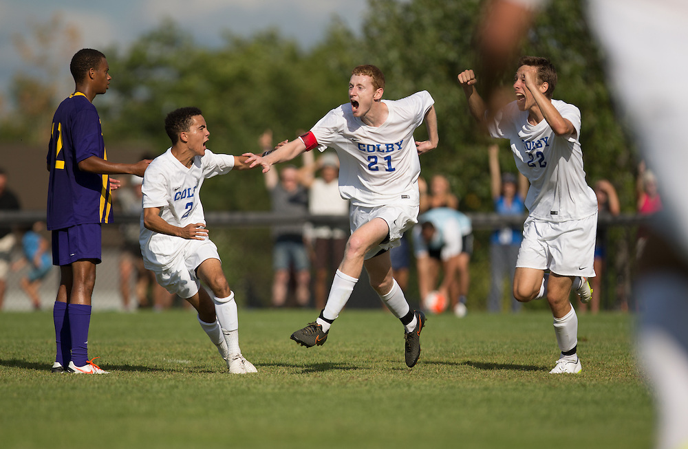 Tim Stanton, Brandon Fahlberg, and Kyle Douglas of Colby College celebrate an overtime winning goal in a NCAA Division III soccer game against Williams College on September 19, 2015 in Waterville, ME. (Dustin Satloff/Colby College Athletics)