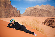 Yoesun Lim relaxes on a red sand dune in Wadi Rum, Jordan.