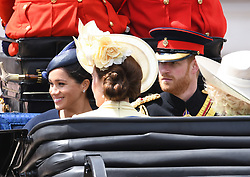 The Duchess of Sussex, The Duchess of Cambridge and The Duke of Sussex attending Trooping The Colour, Buckingham Palace, London. Picture credit should read: Doug Peters/EMPICS