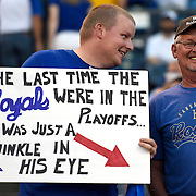 Jared Liles, 27, Nevada, Mo., summed up how long it's been since the Royals were in the post season while he held a sign with his dad, Kenneth Liles beforeTuesday's wildcard playoff baseball game on September 30, 2014 at Kauffman Stadium in Kansas City, MO. Kenneth took Jared to his first Royals game when he was five. Jared bought the tickets for Tuesday night's game.