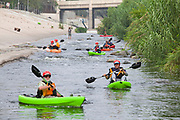 Kayakers stretched out along the LA River. On June 1, 2013, George Wolfe and LA River Expeditions leads a kayak tour down the Los Angeles River. On Memorial Day, the Los Angeles River Pilot Recreational Zone officially opened to the public for kayaking, walking, birdwatching, and fishing along a 2.5 mile stretch of the river in the Elysian Valley. Los Angeles, California
