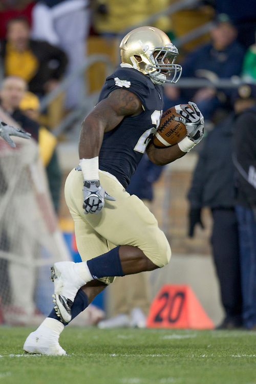 Notre Dame tailback Jonas Gray (#25) runs for a touchdown during first  quarter of NCAA football game between Notre Dame and Boston College.  The Notre Dame Fighting Irish defeated the Boston College Eagles 16-14 in game at Notre Dame Stadium in South Bend, Indiana.