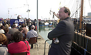 John Griffin looks around the athe magnificent setting in Fenit as Dr. Henry Lyons addresses the crowd at the naming ceremony of the Jeanie Johnston on Sunday..Picture by Don MacMonagle