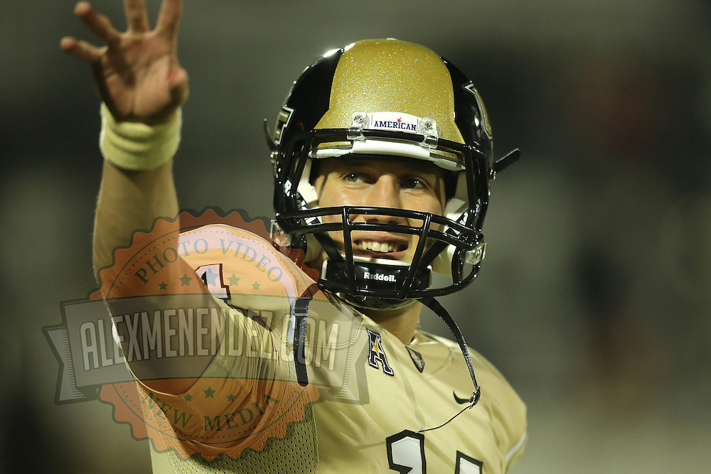 UCF Knights quarterback Pete DiNovo (14) warms up prior to an NCAA football game between the South Florida Bulls and the 17th ranked University of Central Florida Knights at Bright House Networks Stadium on Friday, November 29, 2013 in Orlando, Florida. (AP Photo/Alex Menendez)