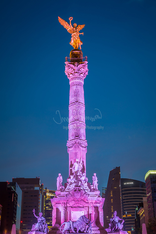 """The Angel of Independence, most commonly known by the shortened name El Ángel and officially known as Monumento a la Independencia (""""Monument to Independence""""), is a victory column on a roundabout on the major thoroughfare of Paseo de la Reforma in downtown Mexico City.<br /> <br /> El Ángel was built in 1910 during the presidency of Porfirio Díaz by architect Antonio Rivas Mercado, to commemorate the centennial of the beginning of Mexico's War of Independence. In later years it was made into a mausoleum for the most important heroes of that war. It is one of the most recognizable landmarks in Mexico City, and it has become a focal point for both celebration or protest. It resembles the July Column in Paris and the Berlin Victory Column in Berlin."""