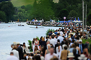 Spectators gather to watch rowing races at the Henley Royal Regatta, an annual event first held in 1839 in Henley-on-Thames, southern England. Off the water, competitors and spectators must adhere to the strict rules that have traditionally governed the dress and comportment of the British upper classes at play.