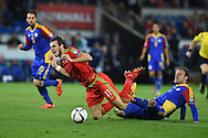Gareth Bale of Wales is fouled by Andorra's Ildefons Lima and a free kick is awarded. Wales v Andorra, Euro 2016 qualifying match at the Cardiff city stadium  in Cardiff, South Wales  on Tuesday 13th October 2015. <br /> pic by  Andrew Orchard, Andrew Orchard sports photography.