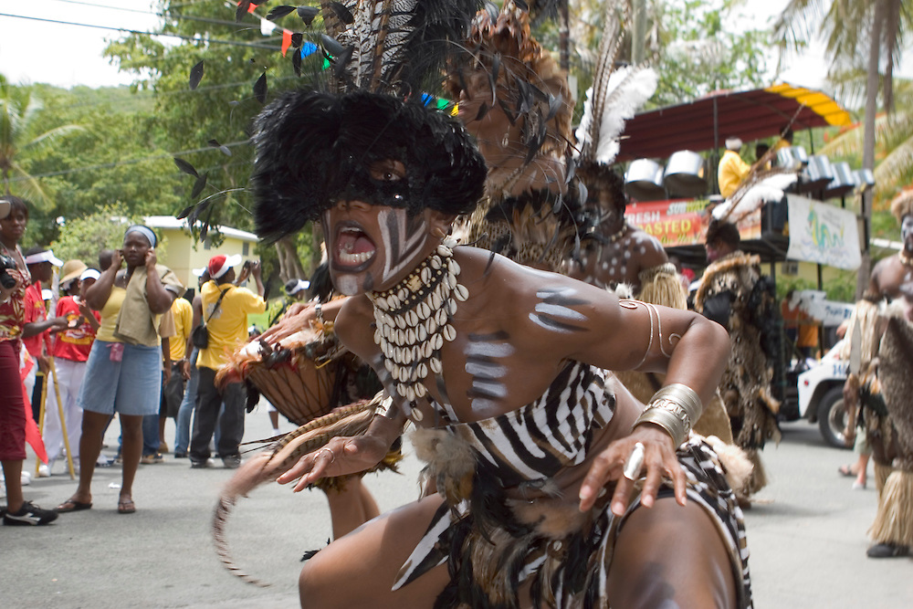 West Indian Native of the Caribbean, preforming a traditional dance during Carnival on St. John, U.S. Virgin Islands.