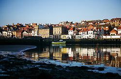 © Licensed to London News Pictures. <br /> 09/04/2017<br /> Whitby, UK. <br />  <br /> Sunlight shines off buildings at sunrise in Whitby in North Yorkshire. <br /> <br /> <br /> Photo credit: Ian Forsyth/LNP