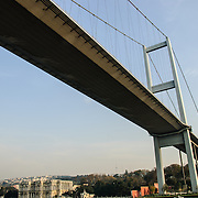 The Bosphorus Bridge, also called the First Bosphorus Bridge  (Turkish: Boğaziçi Köprüsü or  Boğaziçi Köprüsü) is one of the two bridges in Istanbul, Turkey, spanning the Bosphorus strait and connecting Europe and Asia. The shoreline visible in this shot is the Beylerbeyi district on the Asian side.