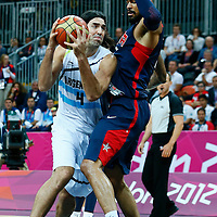 06 August 2012: USA Tyson Chandler defends on Argentina Luis Scola during 126-97 Team USA victory over Team Argentina, during the men's basketball preliminary, at the Basketball Arena, in London, Great Britain.