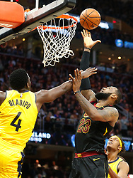 April 25, 2018 - Cleveland, OH, USA - The Cleveland Cavaliers' LeBron James (23) scores against the Indiana Pacers' Victor Oladipo (4) in the third quarter in Game 5 on Wednesday, April 25, 2018, at Quicken Loans Arena in Cleveland. The Cleveland Cavaliers won, 98-95, for a 3-2 lead in the first-round NBA playoff series. (Credit Image: © Leah Klafczynski/TNS via ZUMA Wire)