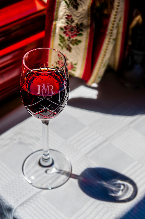 Port wine served in the pillared pre-1940s dining car on the luxury Rovos Rail train between Pretoria and Cape Town, South Africa.
