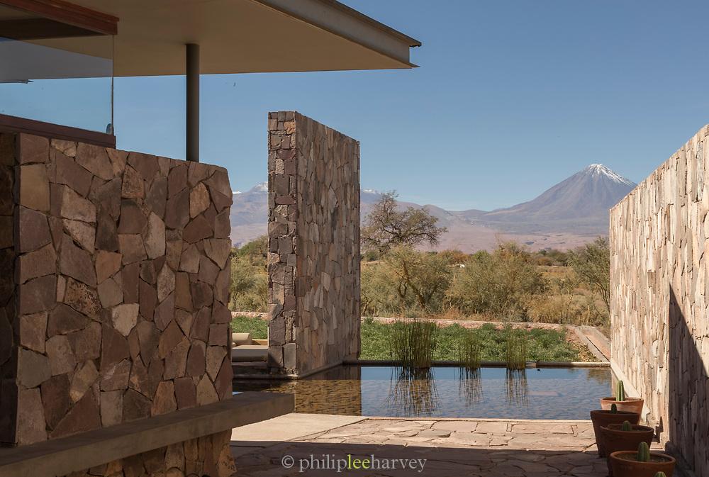 Swimming pool of Tierra Atacama Hotel by Licanabur Volcano in San Pedro De Atacama, Chile