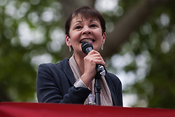 London, UK. 1st May, 2019. Caroline Lucas, Green MP for Brighton Pavilion, addresses climate protesters at a Declare A Climate Emergency Now demonstration in Parliament Square organised to coincide with a motion in the House of Commons to declare an environment and climate emergency tabled by Leader of the Opposition Jeremy Corbyn. The motion, which does not legally compel the Government to act, was passed without a vote.
