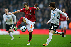Nottingham Forest Forward Billy Sharp (ENG) controlls the ball under pressure from Derby Defender John Brayford (ENG) during the first half of the match - Photo mandatory by-line: Rogan Thomson/JMP - Tel: Mobile: 07966 386802 19/01/2013 - SPORT - FOOTBALL - Pride Park - Derby. Derby County v Nottingham Forest - npower Championship. The meeting of these two local sides is known as the East Midlands Derby with the winner claiming the Brian Clough Trophy.