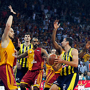 Galatasaray's Ermal KURTOGLU (L), Preston SHUMPERT (C) and Fenerbahce's Roko Leni UKIC (R)  during their Turkish Basketball league Play Off Final fourth leg match Galatasaray between Fenerbahce Ulker at the Abdi Ipekci Arena in Istanbul Turkey on Saturday 11 June 2011. Photo by TURKPIX