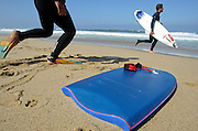 Portuguese Summer. Surfers warm before entering the water at Praia Grande in Sintra.