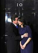 © under license to London News Pictures. 11/05/10. David Cameron hugs his wife Samantha on the steps of Number 10 Downing Street after becoming British Prime Minister. British Prime Minister Gordon Brown has resigned his position and David Cameron has become the new British Prime Minister on May 11, 2010. The Conservative and Liberal Democrats are to form a coalition government after five days of negotiation. Photo credit should read Stephen Simpson/LNP