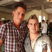 Brandon Warren, left, and Eric Dunn pose for a photo during Fashion On Front Thursday August 21, 2014 at Bakery 105 in Wilmington, N.C.(Jason A. Frizzelle)