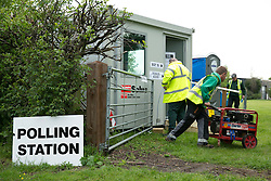 © Licensed to London News Pictures. 07/05/2015. Tamworth, Staffordshire, UK. Polling stations opened at 7 am on the day of the General Election. Pictured, workmen were called to the portakabin Polling Station in Buckingham Road, Tamworth. A generator had failed resulting in no lighting. It didn't stop voting though as the problem was quickly resolved. Photo credit : Dave Warren/LNP