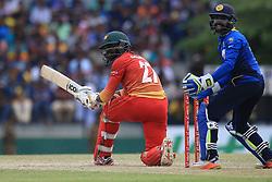 July 8, 2017 - Mahinda, Sri Lanka - Zimbabwe cricketer Solomon Mire(L) plays a shot as Sri Lanka's wicket keeper Niroshan Dickwella(R) looks on during the 4th One Day International cricket matcth between Sri Lanka and Zimbabwe at ..Mahinda Rajapaksa International Cricket Stadium, (southern part of Sri Lanka) at Hambantota, ..Sri Lanka on Saturday 8 th July 2017. (Credit Image: © Tharaka Basnayaka/NurPhoto via ZUMA Press)