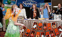 """Princess"" Morgan Maltice is greeted by the Northway Bank/Franklin team of Deborah Jordan, Lorna Thibodeau and Hiedi Kling during the 2011 Business BooFest at Opechee Inn and Spa Conference Center.  (Karen Bobotas/for the Laconia Daily Sun)"