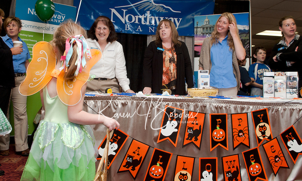 """""""Princess"""" Morgan Maltice is greeted by the Northway Bank/Franklin team of Deborah Jordan, Lorna Thibodeau and Hiedi Kling during the 2011 Business BooFest at Opechee Inn and Spa Conference Center.  (Karen Bobotas/for the Laconia Daily Sun)"""