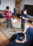 "The Melanson family boys at home after school in their living room in Iqualuit, Canada. Iqaluit, with a population of 6,000, is the largest community in Nunavut as well as the capital city. It is located in the southeast part of Baffin Island. Formerly known as Frobisher Bay, the town is at the mouth of the bay of that name, overlooking Koojesse Inlet. ""Iqaluit"" means 'place of many fish'. Canada. The image is part of a collection of images and documentation for Hungry Planet 2, a continuation of work done after publication of the book project Hungry Planet: What the World Eats, by Peter Menzel & Faith D'Aluisio."