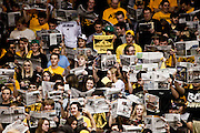 SHOT 1/21/12 5:06:30 PM - Colorado students feign distraction as  Arizona players are introduced during their PAC 12 regular season men's basketball game at the Coors Events Center in Boulder, Co. Colorado won the game 64-63..(Photo by Marc Piscotty / © 2012)
