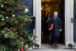 © Licensed to London News Pictures. 19/12/2017. London, UK. Secretary of State for Wales Alun Cairns leaves 10 Downing Street after the weekly Cabinet meeting. Photo credit: Rob Pinney/LNP