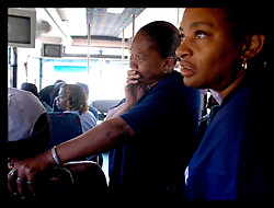 30th Oct, 2005.  After Katrina, New Orleans, Louisiana. Riding on the Grayline bus tour for residents of the Lower 9th ward. Residents can only visit the area on special busses and are not permitted to get off the bus except at one designated location to view a 'typical' house. Petrina Peters (mid) points out her house to her cousin Barbara Cleves as she holds back the tears. Petrina's house was destroyed by the storm. She was rescued from the rooftop two days after the flood waters rose.