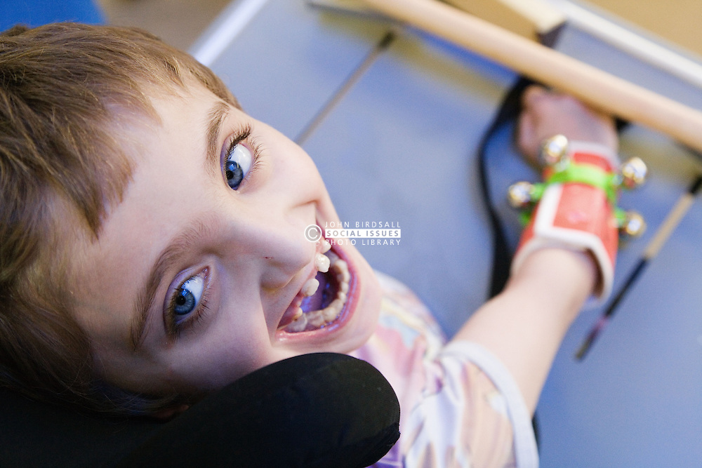 Girl with physical and learning disabilities smiling,