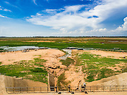 31 MAY 2016 - SIEM REAP, CAMBODIA:  The West Baray is an enormous reservoir by the Khmer empire in the 11th century. It is 8,000 metres long and 2,100 metres wide. It was built by hand and used to provide agricultural and domestic water to the empire based in the Angkor Wat complex. The Baray is still in use as a reservoir for farms in the area. It is empty for the first time in the living memory of the people who live around it. While the water level fluctuates enormously from the rainy season the dry season, it's virtually unheard for the Baray to be empty and it's been empty for at least a month. The boats that take tourists across the reservoir are beached and many of the small restaurants are closed until it floods again. Recent small rains have seen the water level rise a few inches but not enough to accommodate the boats.     PHOTO BY JACK KURTZ