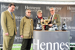 Left to right, JO THORNTON , PAUL & JANET DUFFY owners of Diamond harry winner of the 2010 Hennessy Gold Cup and MAURICE HENNESSY at the Hennessy Gold Cup 2010 at Newbury Racecourse, Berkshire on 27th November 2010.