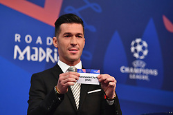 NYON, SWITZERLAND - Monday, December 17, 2018: Former Liverpool player and Champions League winner Luis Garcia holds up Manchester City after making the draw during the UEFA Champions League 2018/19 Round of 16 draw at the UEFA House of European Football. (Handout by UEFA)