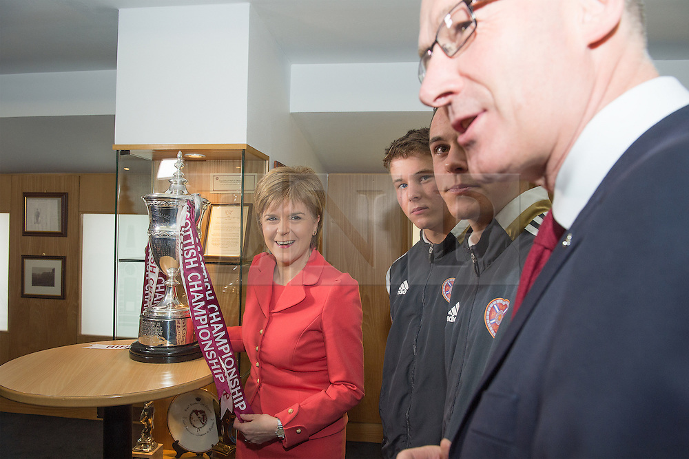 © Licensed to London News Pictures. 26/05/2015.  The First Minister, Nicola Sturgeon during a visit to winners of the Scottish Championship, Heart of Midlothian Football Club with Deputy First Minister John Swinney (far right) , to deliver her first first economic speech since the general election. Photo credit: Max Bryan/LNP